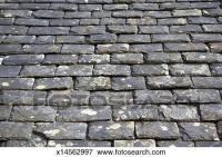 Picture of Old, weathered, heavy slate roof tiles ...