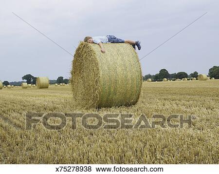 boy sleep in hay
