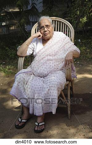 Stock Photography of South Asian Indian old lady sitting on cane chair  India din4010  Search