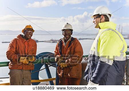 Stock Fotograf  arbeiter sprechen auf bohrinsel