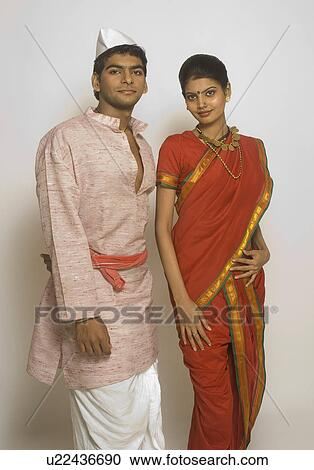 Stock Photography Of Folk Dancers Standing Together In Traditional Maharashtrian Dress U22436690