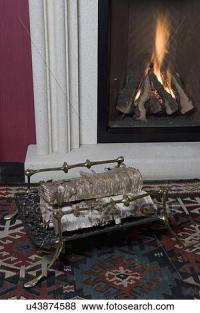 Pictures of FIREPLACES: log carrier made of brass an iron ...