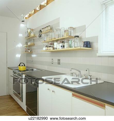 shelves above double white sink in