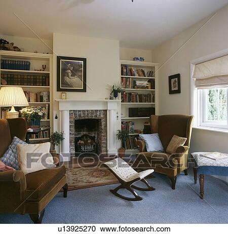 country living rooms with fireplaces room ideas color schemes stock photography of wingchairs and rocking stool in front fireplace