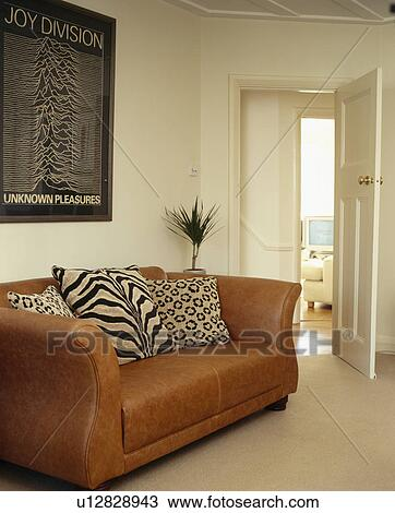photos of living rooms with brown leather furniture room chairs stock photo animalprint cushions on sofa in cream