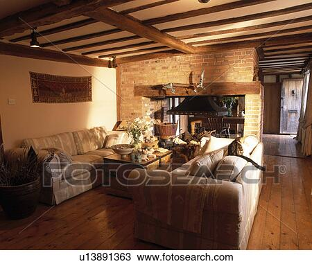 country living rooms with fireplaces coastal room color schemes stock photo of large sofas in beamed fireplace exposed brick wall