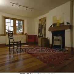 Pictures Of Furnished Living Rooms Elegant Paint Colors For Room Stock Photo Rush Seated Ladderback Chair And Wooden Flooring In Sparsely With Cream Stove Fireplace