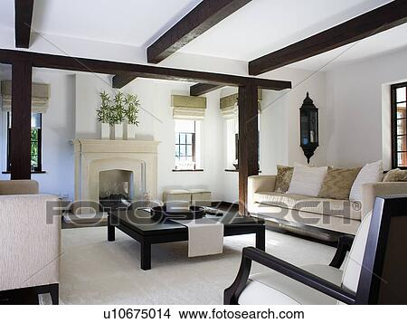low black coffee table and cream sofas