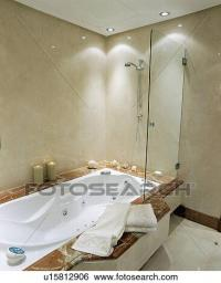 Stock Images of Recessed lighting above shower and bath in