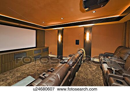Picture Of Empty Media Room With Leather Furniture In