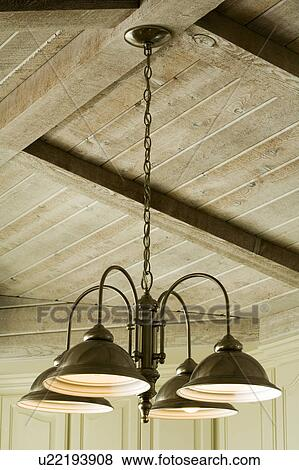 Light Fixture Hanging from Wood Beam Ceiling Stock Photo   u22193908   Fotosearch