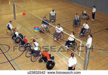 wheelchair volleyball modern brown leather office chair stock photo of several people with disabilities playing a game on an indoor court