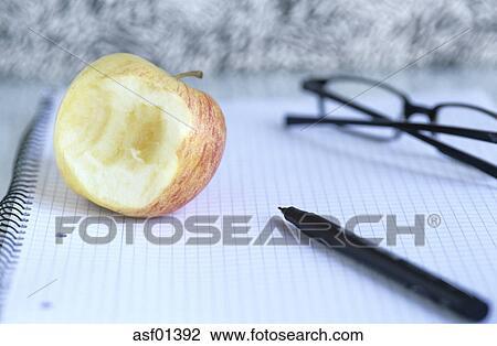 half eaten apple and