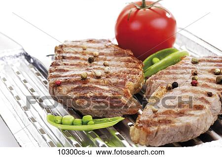 Grilled rumpsteak on aluminium grill pan Stock Photograph   10300cs-u   Fotosearch