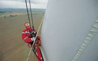 Don't Look Down: These Wind Power Techs Dangle from Massive Turbine Blades