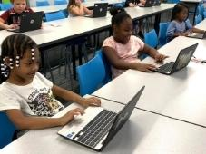 Kids working on computers
