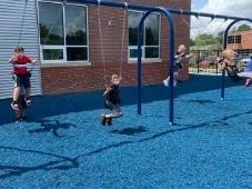 Students swinging on playset
