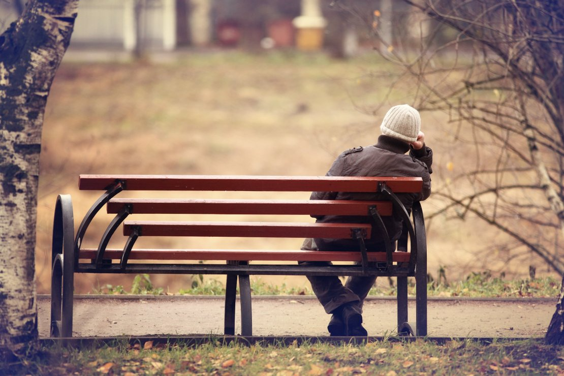 Lonely Man on a Bench in Autumn