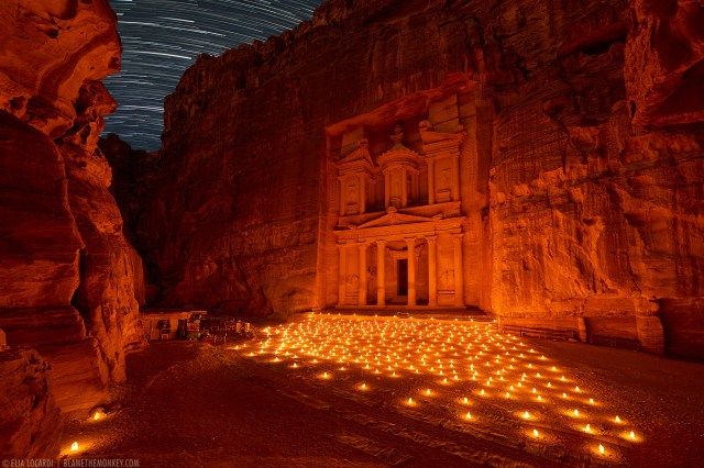 The stars dance with the candlelight at night in the ancient archaeological site of Petra Jordan.