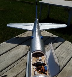 the vertical stabilizer is also a double piece of foam reinforced with reinforced with bbq skewers for the rudder servo i cut a hole large enough for a 9g  [ 3024 x 4032 Pixel ]
