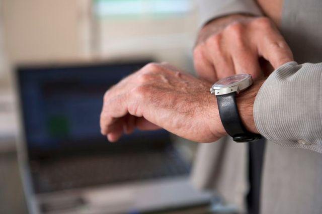man checking wristwatch