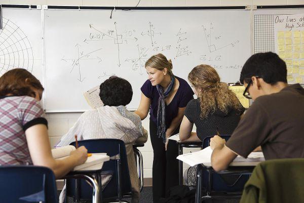 Teacher Helping High School Students
