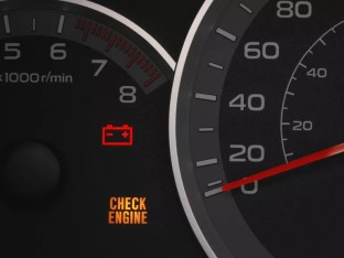 car instrument cluster showing check engine light and battery light, which could mean the car battery is dead