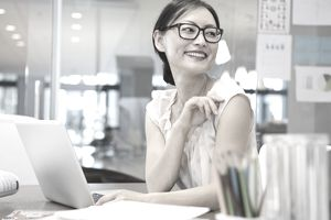 Businesswoman looking away at office desk