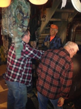 The Ol' Farts hugging the wood stove!