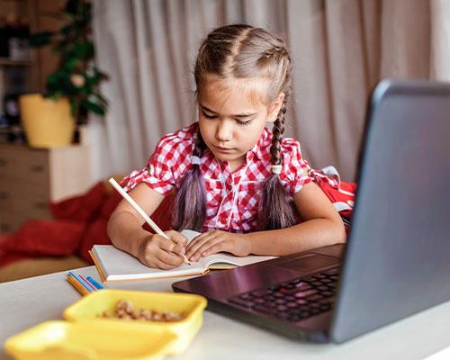 Elementary girl doing online school