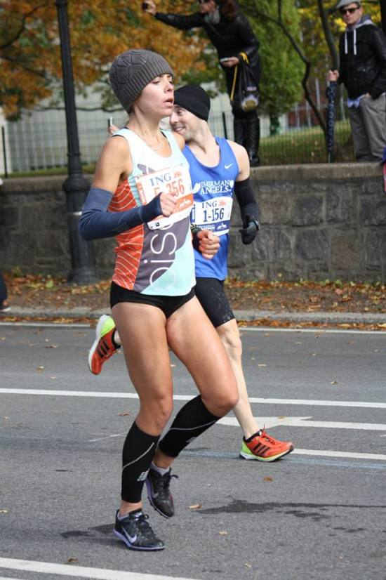 Thanks to the famous jewelry designer Erica Sarah for this shot.  #Neverforget the dry heaving at mile 24.