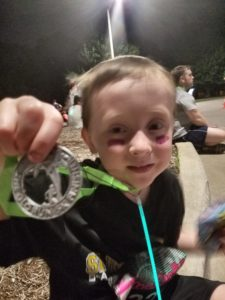 Aidan and his medal