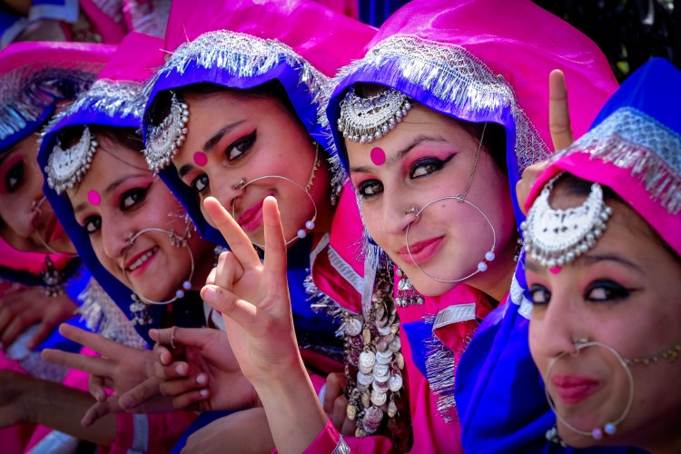 """Shimla, Himachal Pradesh, India. Young women in traditional dress during Himachal Day. Himachal Day celebrates the creation of the State of Himachal Pradesh after independence in 1948. Hima means snow in Sanskrit and Himachal literally means """"The land of snow"""""""