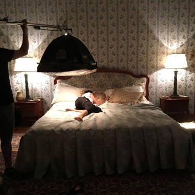 Stand-in actress on interior set during lighting set up
