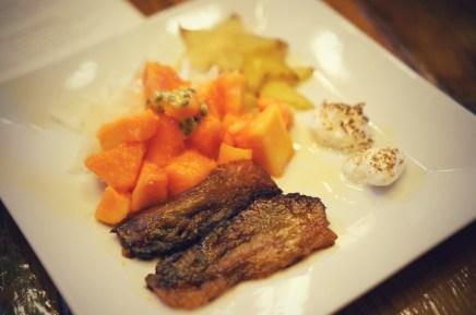 tropical winter salad   papaya, starfruit, jicama, mango & habanero glazed crispy pork cheek, coconut & cardamom meringue