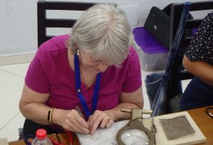 Woman working on filigree art project