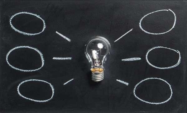 light bulb in black background