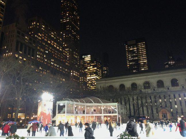 View of Midtown Manhattan and Ice Skating Rink in Bryant Park