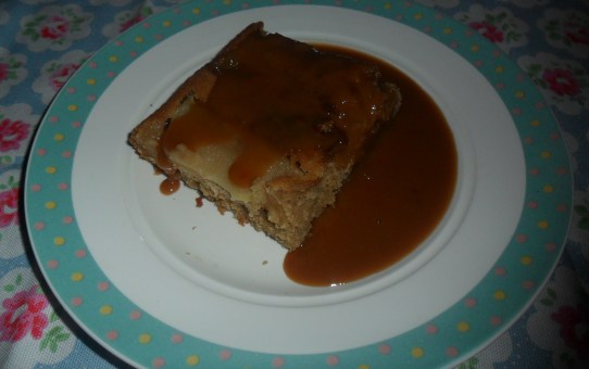 Spiced apple and ginger traybake with easy toffee sauce.