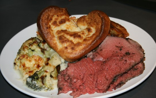 Slow roast beef with a pepper and rosemary crust