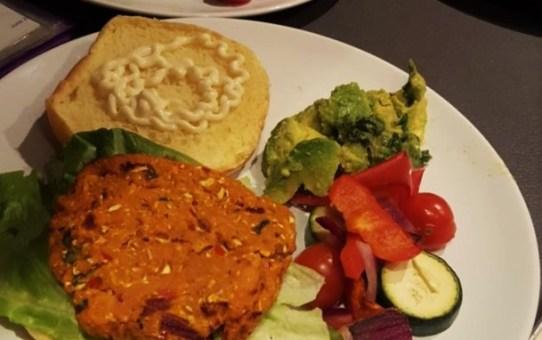 Spiced sweet potato burger with avocado and basil salsa