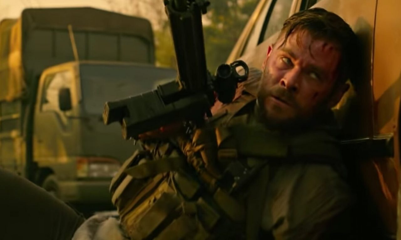 Extraction Movie Review - Rakes (Hemsworth) with a fun behind a car