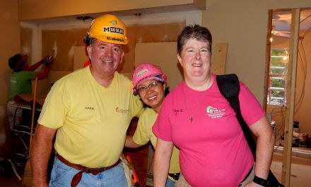 """Karen Warkentien (right) poses with friends Eddie and Nicetas Proctor at the Legacy Build. Better known as """"Toolie,"""" Karen started as a volunteer but now also serves as a member of The Fuller Center's International Board of Directors. We asked her about why it is important for her to continue volunteering while also serving as a board member."""
