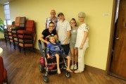 FCH's newest partner family, The Petersons, with board member Linda Myers