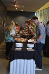 Photo: Attendees at the 7th Annual Fuller Center for Housing of Greater Kansas City Barbecue, Benefit, and Celebration line up to feast on the delicious barbecue at the event