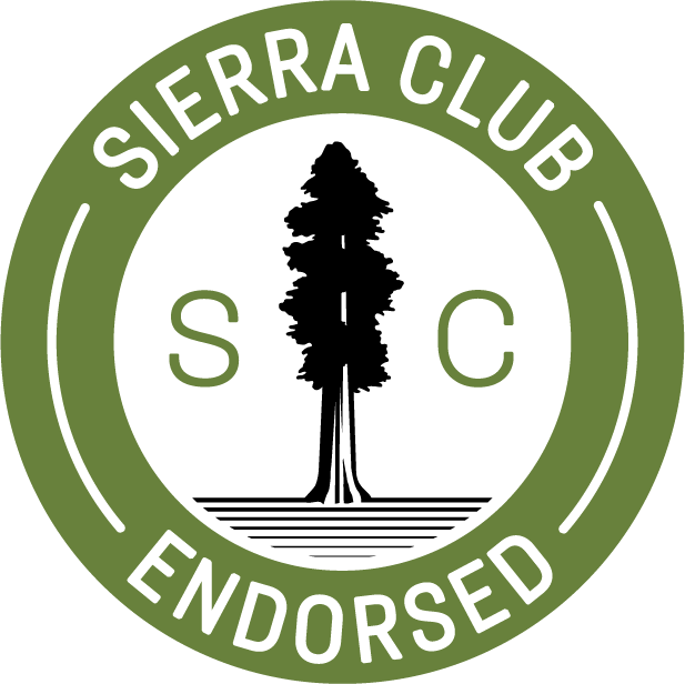green circle with Sierra Club Endorsed in white letters, black pine tree in center with white background captital S C in green letters in center