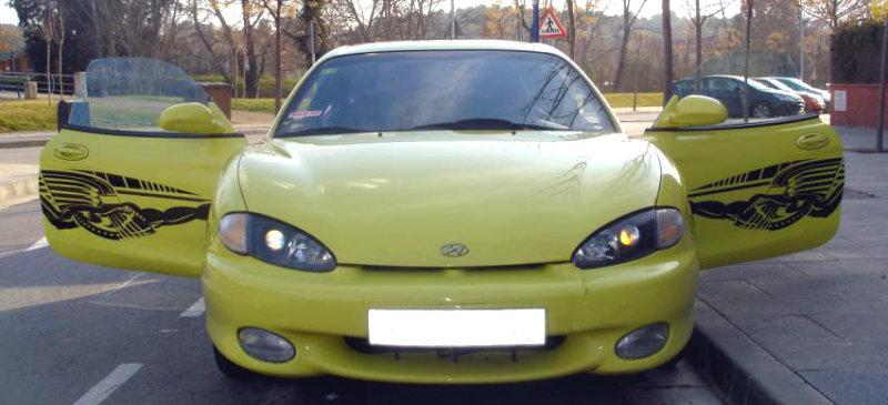 Furious and yellow, black vinyl on a yellow Hyundai.