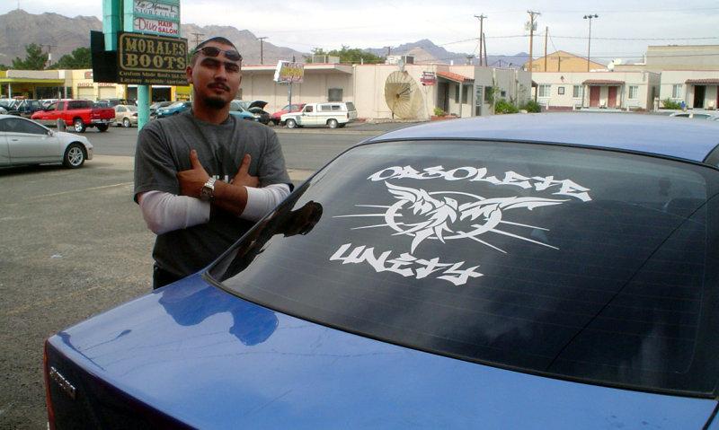 Car-club back-window decal using tagger graffiti font and custom-drawn image