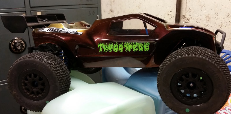 Remote control car with lime green decals applied to side panels