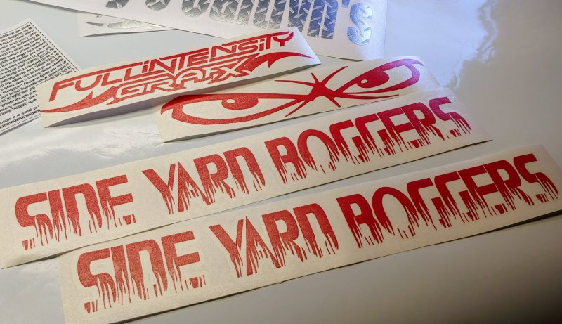 our logo decals in red, and two custom lettering decals